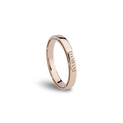 Fede nuziale in oro rosa con diamante