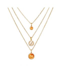 Multi-strand necklace with cubic zirconia and orange and beige cabochon
